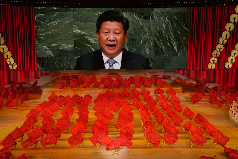 習近平上台後力推紅色政策,讓中共重回中國人的生活中心,並藉此收緊個人權力。(美聯社)