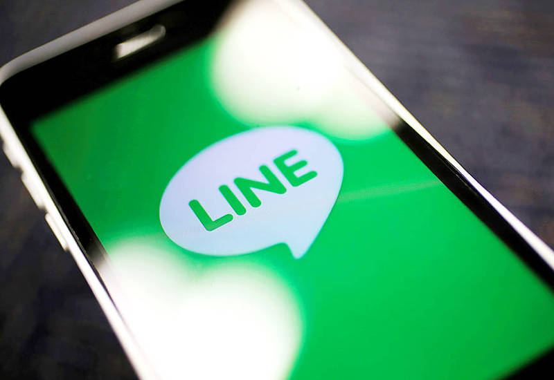 The logo of the mobile messaging app Line is displayed on a smartphone in a photograph taken in Tokyo on Sept. 23, 2014. Photo: Reuters