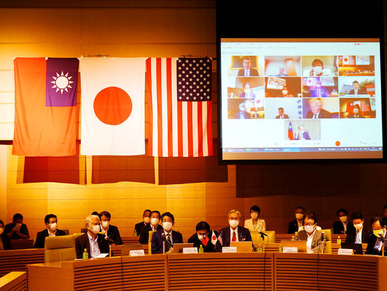 The first strategic forum for Taiwanese, US and Japanese lawmakers and officials, including special guest former Japanese prime minister Shinzo Abe, front row second left, takes place yesterday in Tokyo, with overseas attendees participating virtually. Photo: CNA
