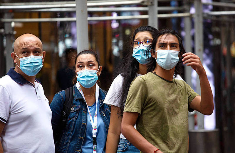 People wear face masks in New York's Midtown Manhattan on Thursday. Photo: AFP