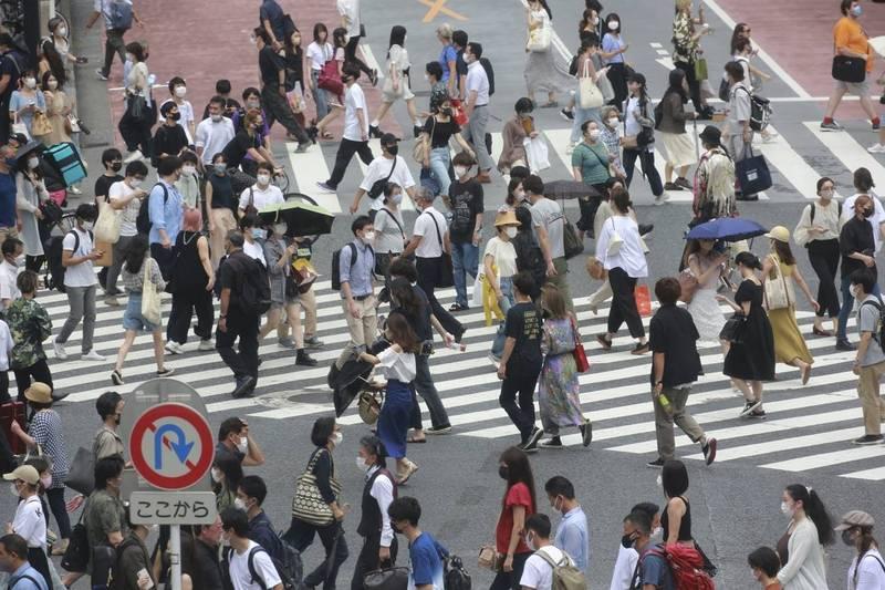 東京都今(31)日單日新增確診共4058例,成為東京都首次單日新增確診破4000例紀錄。圖為東京街景,示意圖。(美聯社)