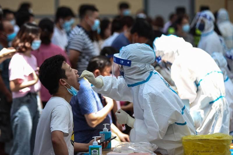 中國昨再度新增確診病例55例,除了江蘇本土病例不減之外,湖南、重慶、遼寧、福建、四川等地也出現本土病例。(法新社)