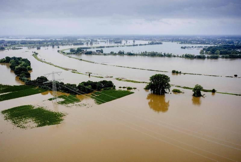 今年洪災畫面,專家憂心劇烈天災會愈來愈常發生。(法新社)