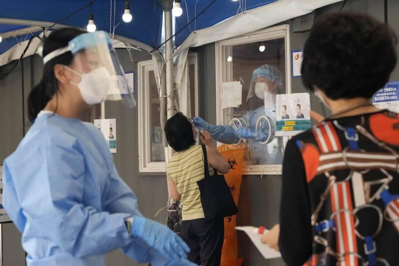 南韓昨新增1202例確診病例,已是連續第28天超過1000例確診。(美聯社)