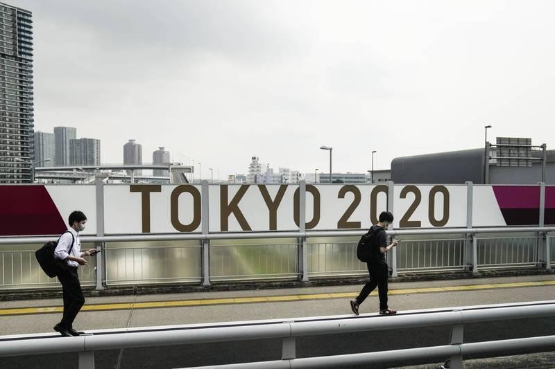 謝金河分析為何日本政府堅持舉辦奧運,還說這次東奧,很可能成為日本和台灣的重要轉捩點。(美聯社)