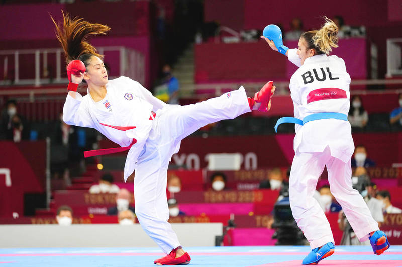 Taiwan's Wen Tzu-yun, left, and Ivet Goranova of Bulgaria compete in the women's kumite under-55kg elimination round at the Tokyo Olympics yesterday. Photo: AP