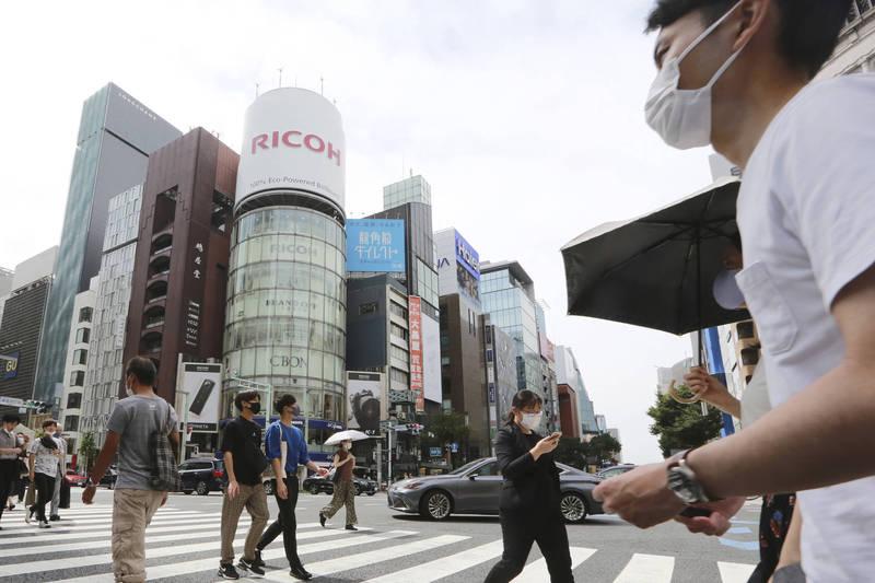 日本23日新增1萬6841例確診病例。圖為東京街景,示意圖。(美聯社)