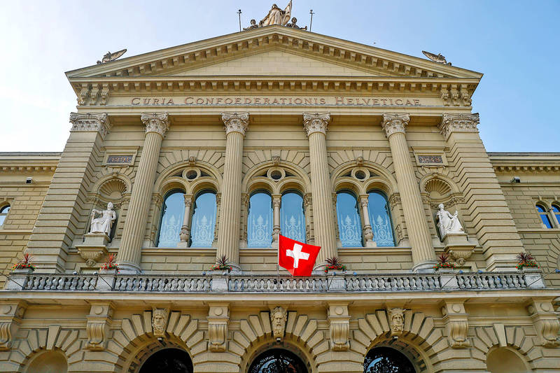 The Swiss national flag is pictured at the Federal Palace in Bern on June 17. Photo: Bloomberg
