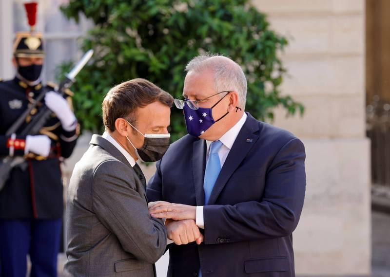 澳總理莫里森(右)澄清,數月前已和法總統馬克宏(左)表達取消軍購合約的可能性。(路透)
