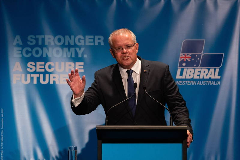 澳洲總理莫里森宣布,將開放「完整接種疫苗」的旅客入境雪梨,並將14天檢疫期減半,同時試用「居家檢疫系統。」(歐新社)