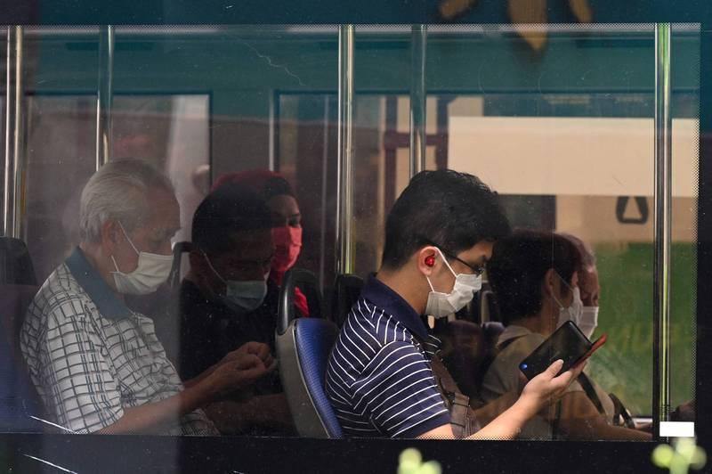 新加坡武漢肺炎疫情再度升溫,18日新增1009人確診,創自去年4月23日以來新加坡單日確診紀錄。(法新社)