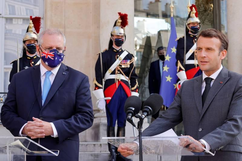澳洲總理莫里森(圖左)指出,現階段沒機會與法國總統馬克宏(圖右)單獨會晤,資料照。(路透)