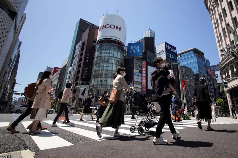 日本大阪發生有幼兒園園長要求員工隱瞞疫調事件,之後有其他員工和孩童也確診,事情才曝光。大阪街景。(法新社)