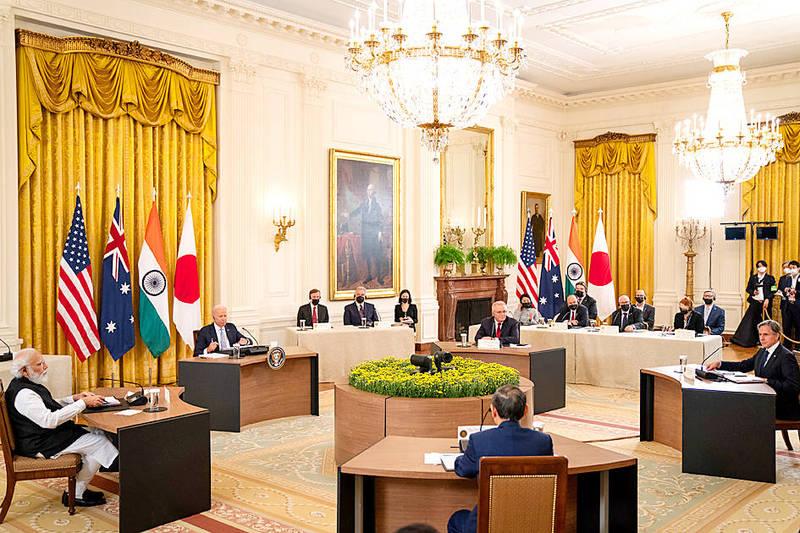 US President Joe Biden, second left, hosts a summit with Indian Prime Minister Narendra Modi, left, Japanese Prime Minister Yoshihide Suga, bottom center, Australian Prime Minister Scott Morrison, top center, and US Secretary of State Antony Blinken, right, in the East Room at the White House in Washington on Friday. Photo: EPA-EFE