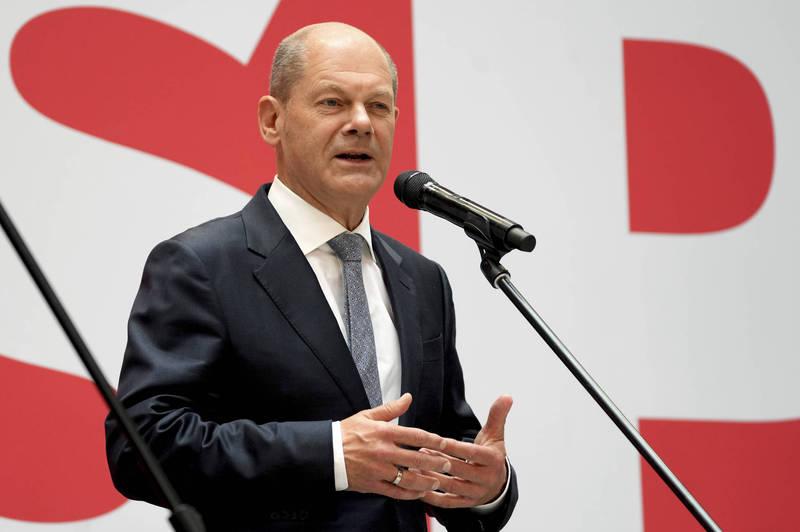 德國社民黨贏得此次大選,社民黨總理候選人蕭茲表示他希望能與綠黨還有自由民主黨合作執政。(美聯社)