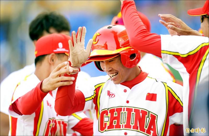 中國隊羅錦駿敲出逆轉超前安。(記者林正堃攝)