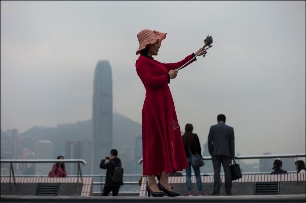 北京對香港的政經戰略部署,最終目標就是讓香港完全融入中國,防杜普世價值透過香港對「內地」產生示範作用。(歐新社)
