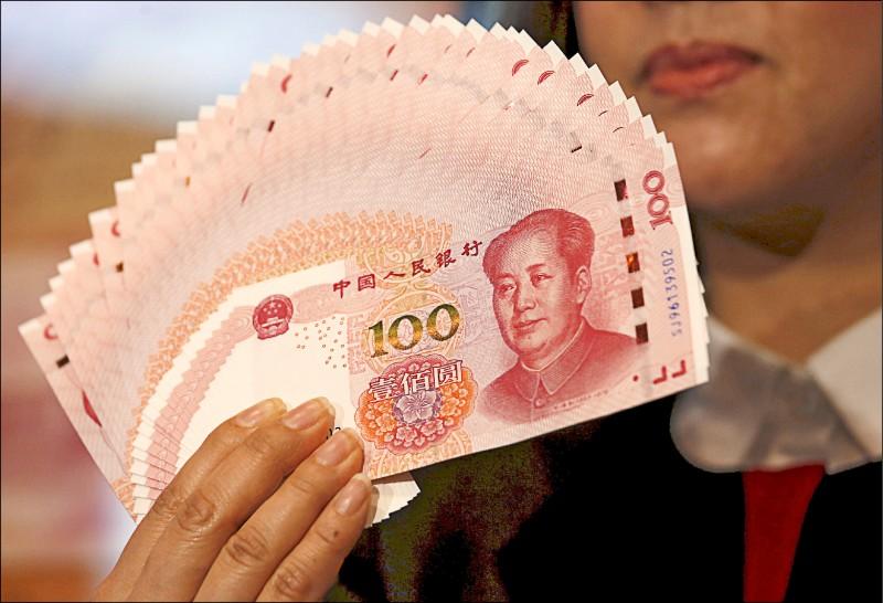 匯率是中國用以竊奪世界的主要武器,藉其專權之利,中國自採取社會主義市場經濟後,就有計畫地逐年將人民幣幣值予以壓低。(路透檔案照)